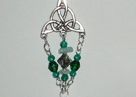 Celtic triquetta necklace with celtic knots, aventurine stone, and celtic image charm.