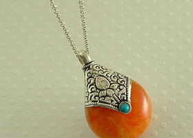 Yellow necklace of amber and turquoise inlaid pendant necklace