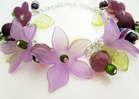 Purple Lucite Flower Bracelet With Leaves and charms