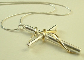 Silver and gold cross pendant necklace on sterling silver chain necklace