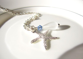 white sea glass with bright starfish & sapphire swarovski crystal