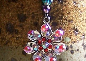"Swarovski Crystal Covered Tibetan Silver Charm Pendat on a 16"" silver plated chain"