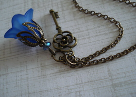 $1 Starting Bid Blue Flower Necklace with Key in Antique Brass
