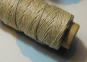 One New 100 foot spool of top quality, imported, 3-ply polished 0.5mm thick hemp cord in natural tan