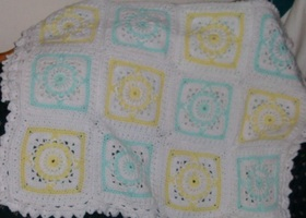 "Gently used crib sized afghan approx 40""x50"""