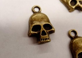Antique bronze skull charms