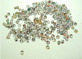 Over 200 glass faceted beads, 4mm in size, mostly purple with red and gray also