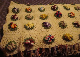 Hand made crocheted throw with flowers