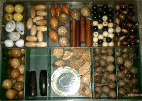 Over 150 Wooden & Shell Beads in Case