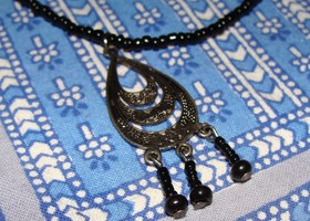 Black Beaded Necklace With Tear Drop Pendant