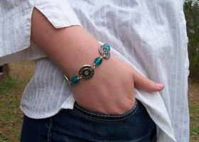 Silver Medallion Bracelet with Teal glass beads.