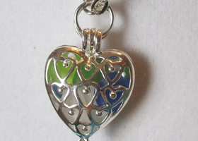 silver filigree reversable  heart locket /bridesmaid gift with tiny beach glass shards