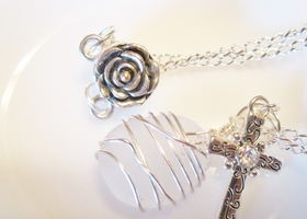 silver cross with white wire wrapped beach glass necklace