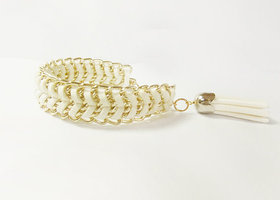 Leather wrapped in gold tone chain bracelet