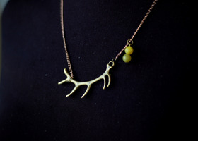 antler and yellow jade necklace
