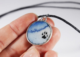 Hand painted sky blue paw pendant