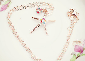 18k rose gold plated starfish necklace with swarovski accents.